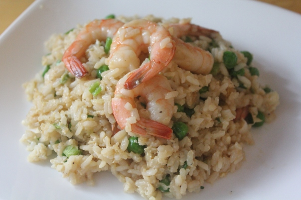 Fried rice with shrimp, eggs, peas, and scallions.